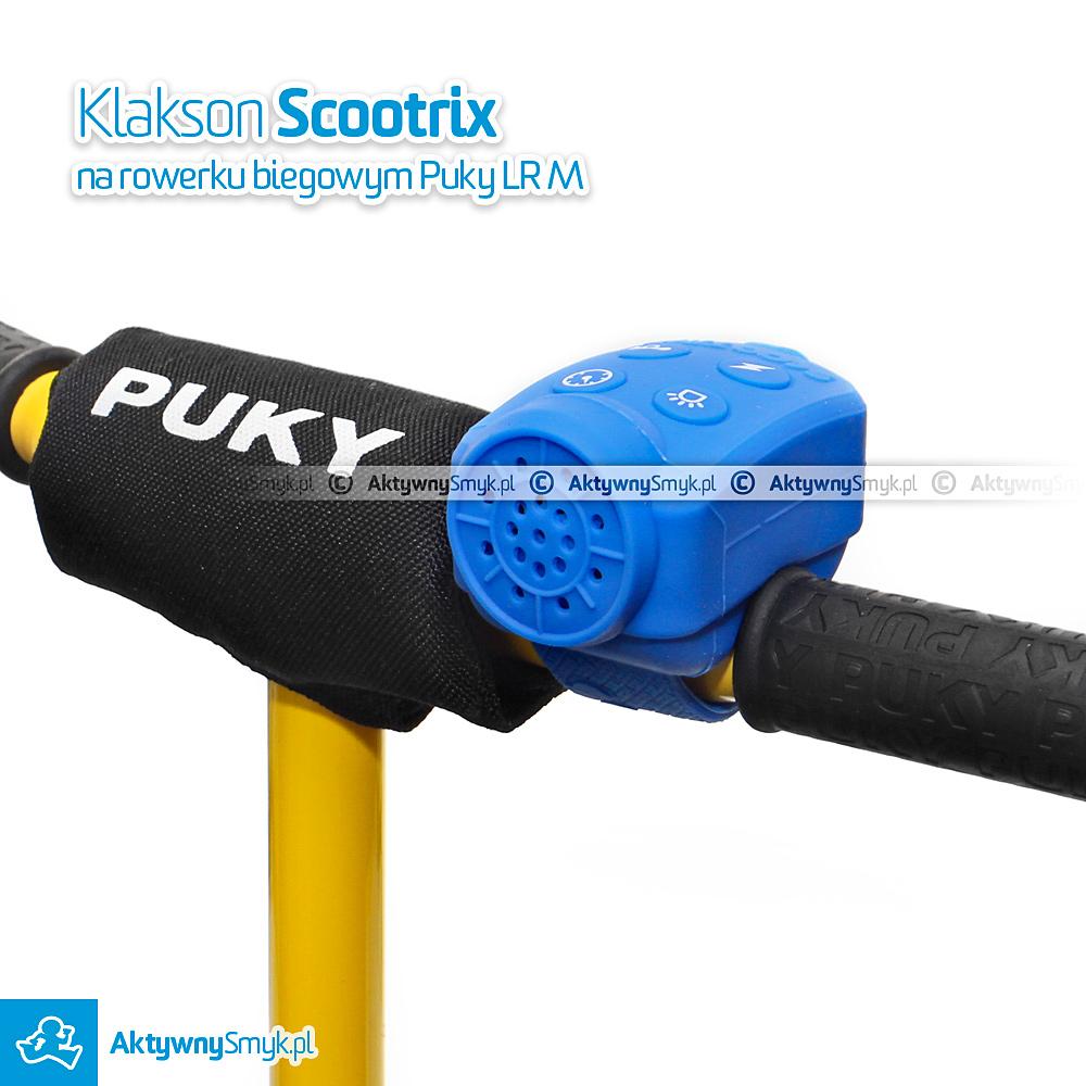 Klakson Scootrix zamontowany na kierownicy rowerka biegowego