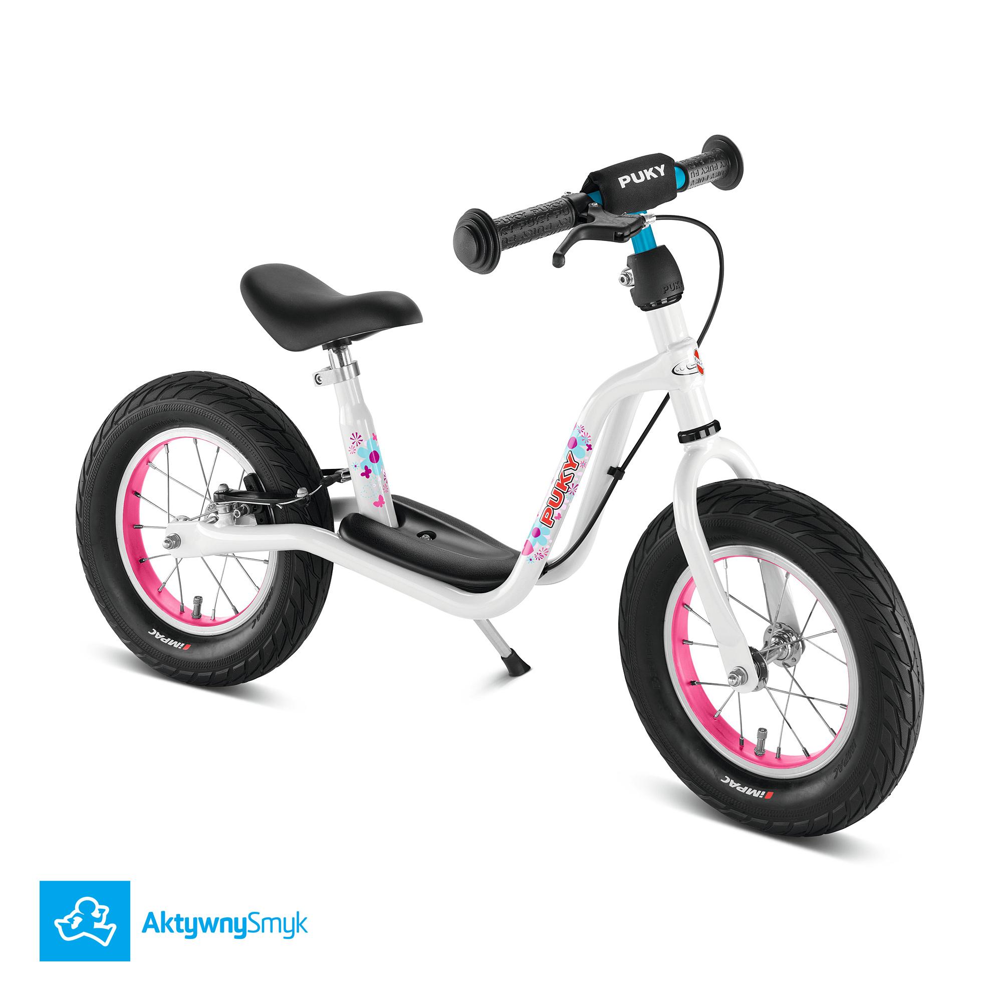 """Biały rowerek biegowy Puky LR XL posiada regulację siodełka w zakresie od 41 do 51 cm, regulowaną na wysokość kierownicę bez blokady skrętu, pompowane opony 12x2,40"""" oraz mocny hamulec tylnego koła typu v-brake. LR XL waży ok. 5,6 kg."""